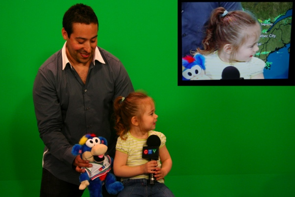 One of the younger viewers at the green screen (inset top right: what she looks like on camera)