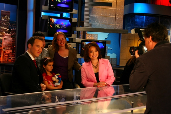 Dominique Jarry-Shore and family with the news anchors