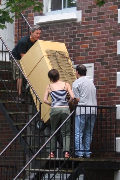 This group took about 15 minutes to haul a fridge up a flight of stairs. For a little while, it looked like it might end in disaster.