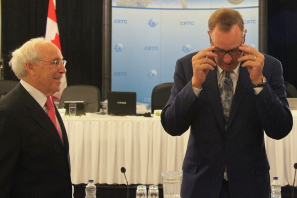 Astral CEO Ian Greenberg, left, with BCE CEO George Cope at May's CRTC hearing